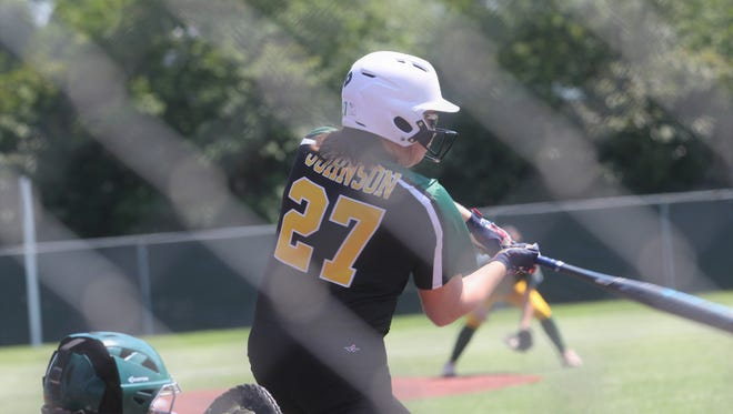 Menard's Olivia Johnson (27) blasts a three-run home run against Calvary in the Division III semifinals. Johnson is the District 4-2A MVP.