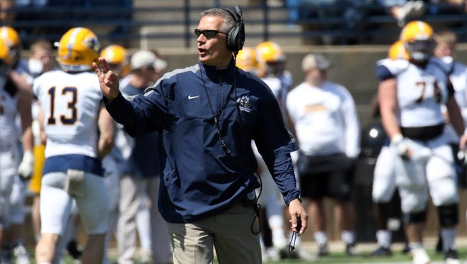 Augustana Head Coach Jerry Olszewski signals to the officials during Saturday's spring game at Kirkeby-Over Stadium in Sioux Falls.