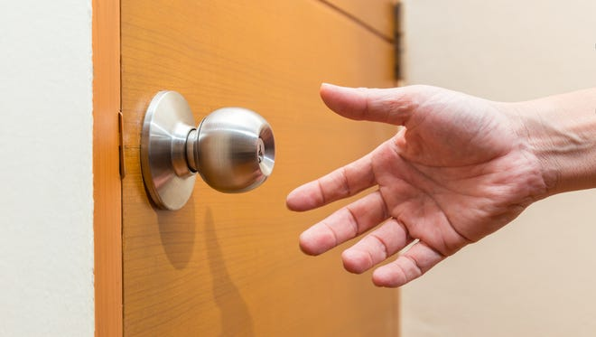 hand reaching out to door knob