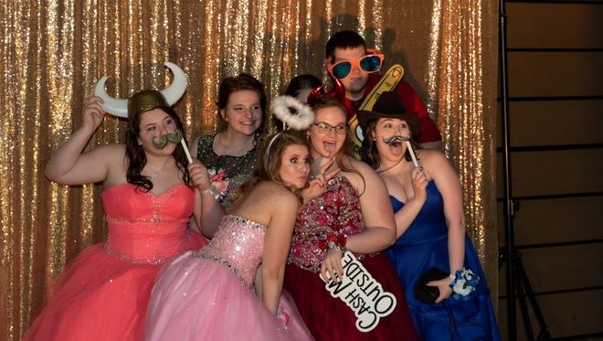 Students pose for photos during the Lincoln High School Prom on Saturday, May 5, 2018, at the high school in Wisconsin Rapids. Courtesy of Michael and Trisha Hammitt