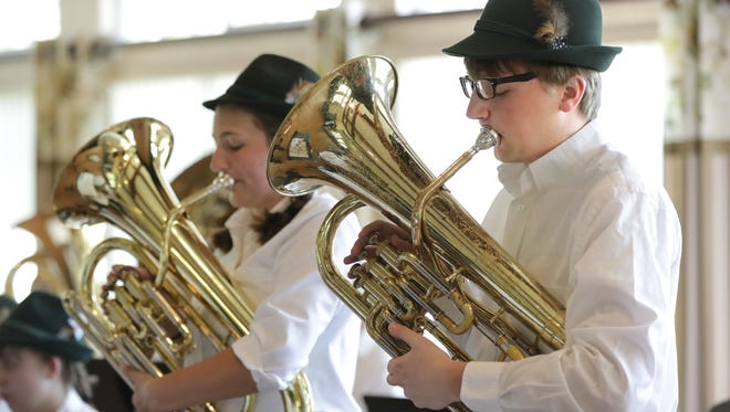 Rachel Foster, left, on tenor horn, and Andrew Prideaux, on baritone, play a song as members of Wespenmusikanten during a 2017 concert at Hallmark Place in Kimberly.