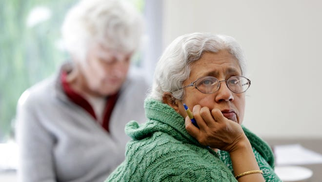 In this April 13, 2018 photo, Sara Dhamija, right, listens to a teacher during an anti-bullying class at the On Lok 30th Street Senior Center in San Francisco.