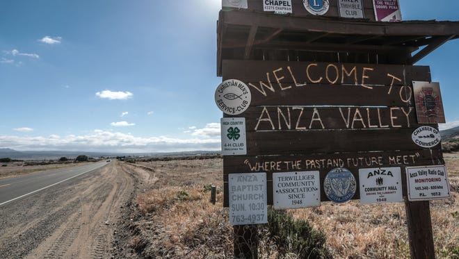 A sign welcome visitors to Anza on Saturday, May 12, 2018.