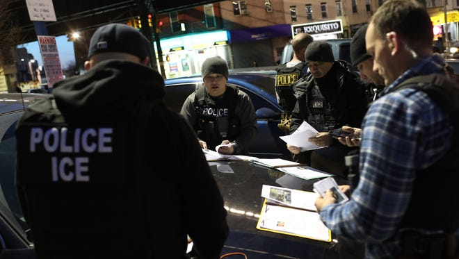 Immigration and Customs Enforcement (ICE) agents prepare for morning raids to arrest undocumented immigrants on April 11, 2018, in New York City.