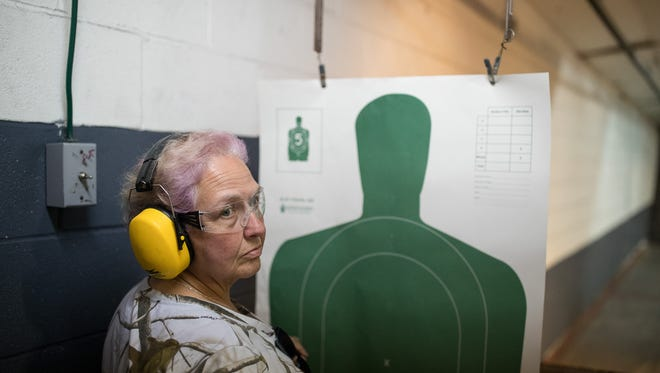 Terry Gallub-Croft of Santa Fe Texas, waits for instruction May 19, 2018, as she takes a license-to-carry-handguns class at Big Kountry Shooting in Alvin, Texas, a day after a shooting at Santa Fe High School killed 10 people.