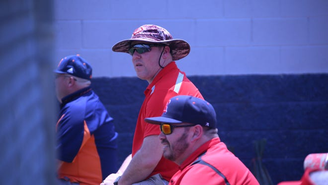 Former Rossview baseball coach Jason Rice sits near the Hawks' dugout during their state tournament game against Collierville on   Wednesday afternoon.