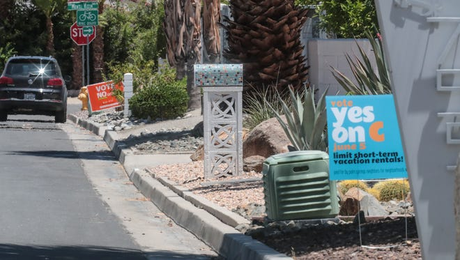 Lawn signs for and against Measure C at the Vista Las Palmas neighborhood in Palm Springs on Saturday, May 26, 2018.
