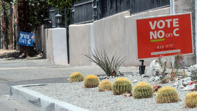 A no and yes to Measure C signs alternate from house to house in the Vista Las Palmas neighborhood in Palm Springs on Saturday, May 26, 2018.