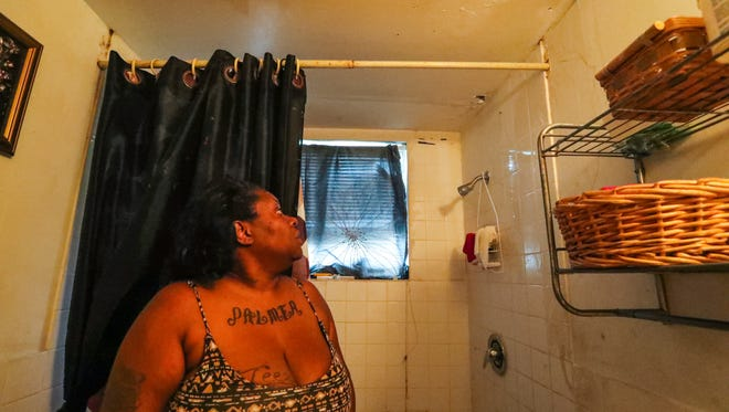 Ebony Lee talks about how bad her bathroom ceiling is at Fort Myers' Jones Walker apartments. The complex is endangering its tenants with falling ceilings, mold and roaches and more due to current and past owners' neglect.