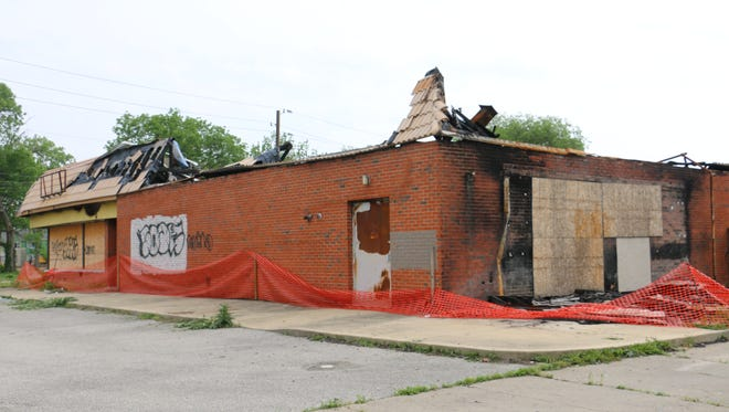 Neighbors have filed about two dozen complaints with the city about this former Hardees' on West Washington Street. A fire destroyed much of the roof last year