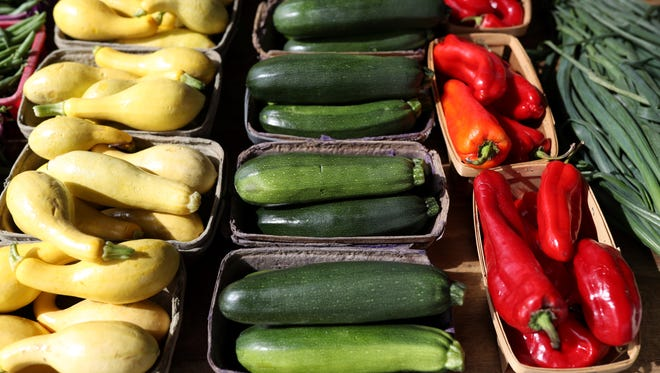 Fresh squash, zucchini and red peppers at the Market Square Farmer's Market.