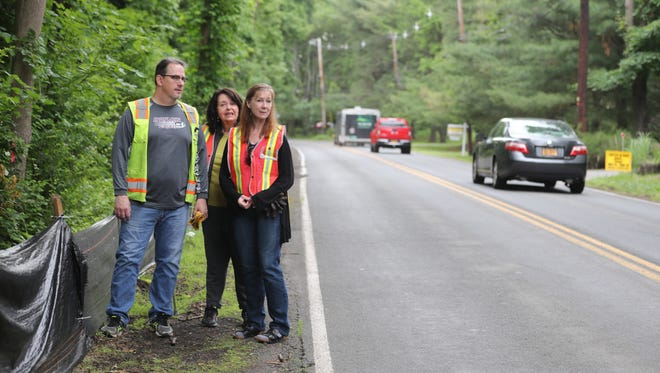 Pat Hill, Annette Burke, and Pat's wife Carolyn, members of a grassroots volunteer group called Turtles of Western Highway, stand on Western Highway in Blauvelt June 7, 2018. Volunteers from the group man Western Highway looking for turtles that cross from the wetlands where they live to the other side of Western Highway during the mating season in order to find appropriate nesting sites. Over the years, numerous turtles have been struck and killed by passing cars. The group has posted warning signs for drivers and has had plastic barriers placed on the side of the road to discourage turtles from crossing.