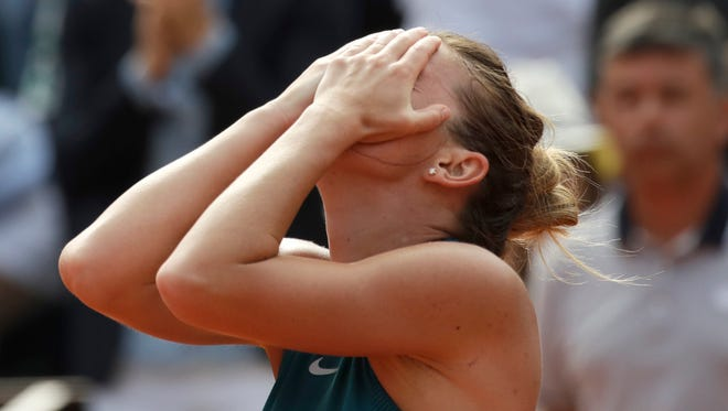 Romania's Simona Halep celebrates wining the final match of the French Open tennis tournament against Sloane Stephens of the U.S. in three sets 3-6, 6-4, 6-1, at the Roland Garros stadium on June 9.