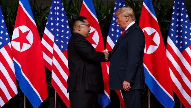 President Donald Trump meets with North Korean leader Kim Jong Un on Sentosa Island on June 12, 2018, in Singapore.