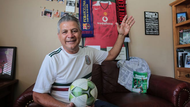 Soccer fanatic Juan Perezchica at his Cathedral City home with some of his soccer memorabilia and family photos behind him on Wednesday, June 13, 2018. Perezchica travels the world frequently to attend soccer games.