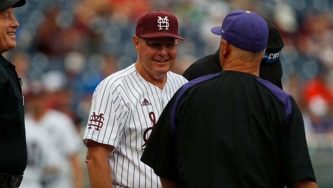 Jun 16, 2018; Omaha, NE, USA; Mississippi  State Bulldogs head coach Gary Henderson (middle) and Washington Huskies head coach Lindsay Meggs (right) share a laugh prior to their game during the College World Series at TD Ameritrade Park. Mandatory Credit: Bruce Thorson-USA TODAY Sports