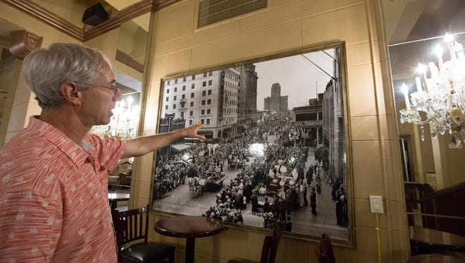 Robert Melikian describes an old image of downtown Phoenix hanging in the Hotel San Carlos on May 30, 2018, in downtown Phoenix.