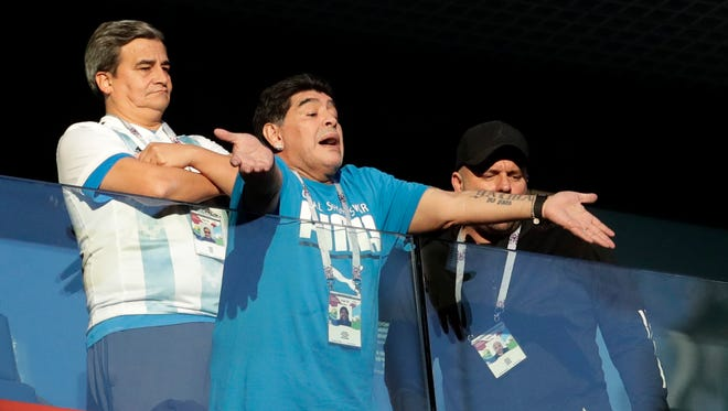 Argentina former soccer star Diego Maradona is making headlines as he roots for his country in the World Cup.