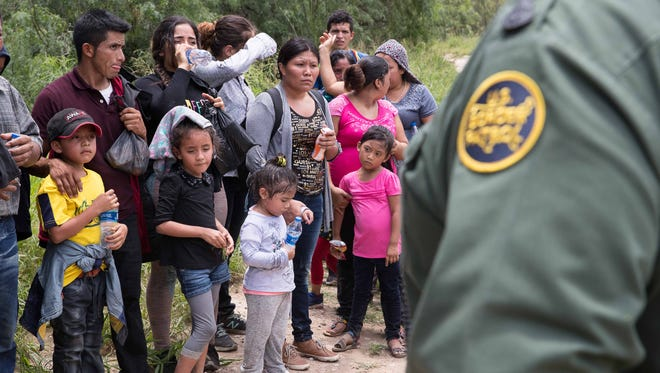 A group of migrant families are intercepted by Border Patrol near McAllen.