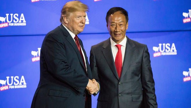 President Donald Trump greets Foxconn chairman Terry Gou  Thursday, June 28, 2018, at the Foxconn Opus Building in Mount Pleasant, Wis.