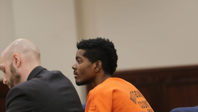 Shundarian Taylor with his attorney, Daniel Ufford at a preliminary hearing on July 10.