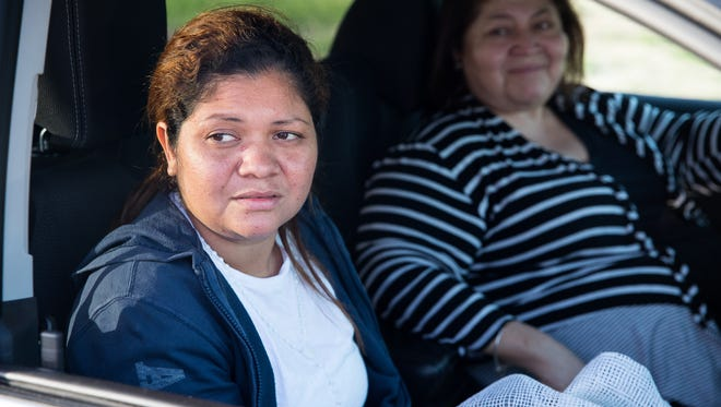 Cindy Alinette Madrid-Henriquez sits in a car outside the Port Isabel Detention Center in Los Fresnos, Texas after being released by ICE on Wednesday, July 11, 2018. Madrid-Henriquez's daughter was heard in the audio clip recorded in a border patrol distribution center.