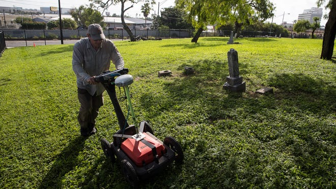 Chester Walker from the Texas Cemetery Restoration pushes a ground penetrating radar across the Old Bayview Cemetery as they a make radar mapping of the cemetery on Tuesday, July 17, 2018.