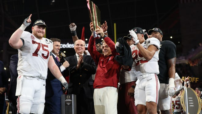 Alabama coach Nick Saban holds the championship trophy after beating Georgia in the College Football Playoff championship game.