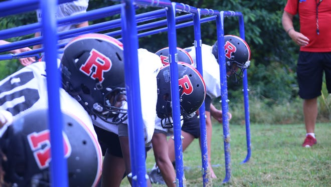Rossview linemen go through drills on the first day of full pads during practice Monday.