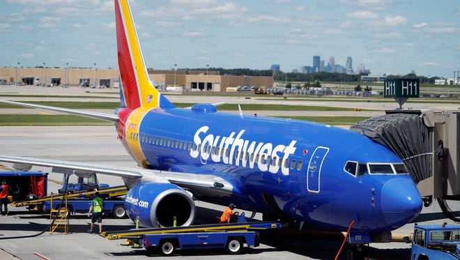 Ramp workers prepare a Southwest Airlines Boeing 737 for departure July 17, 2018, to Denver from Minneapolis International Airport in Minneapolis.