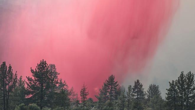 Fire retardant drop near Lake Hemet to fight the Cranston Fire on Thursday, July 26, 2018.
