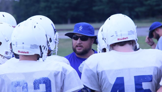 Fort Campbell coach Josh Robins talks with his team during a practice session Wednesday.