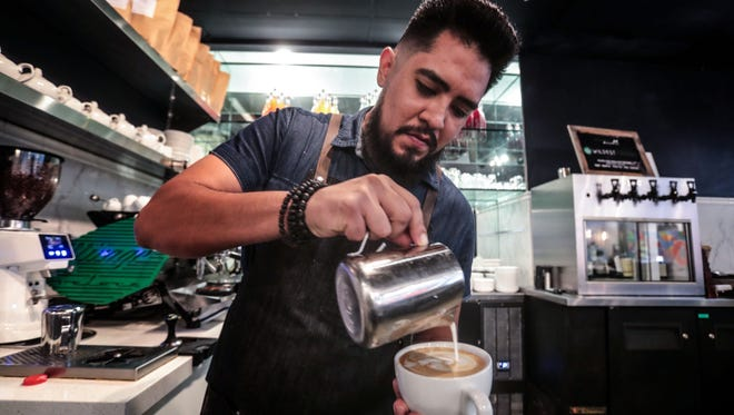 Barista Steve Garcia pours a pattern on a latte at work in Palm Desert on Friday, August 3, 2018. The Coachella native hopes to bring specialty coffee to the eastern Coachella Valley with his new shop Sixth Street Coffee to be located in the City of Coachella's new library.