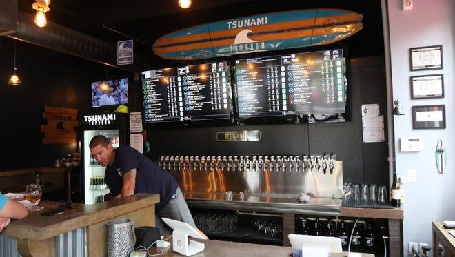 Jason Puttkammer behind the bar at Tsunami Taproom.