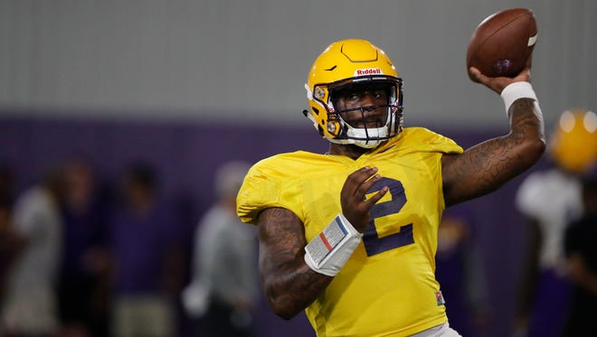 LSU quarterback Lowell Narcisse (2) passes during their NCAA college football practice in Baton Rouge, La., Monday, Aug. 6, 2018. (AP Photo/Gerald Herbert)