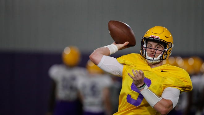 LSU quarterback Joe Burrow (9) passes during their NCAA college football practice in Baton Rouge, La., Monday, Aug. 6, 2018. (AP Photo/Gerald Herbert)