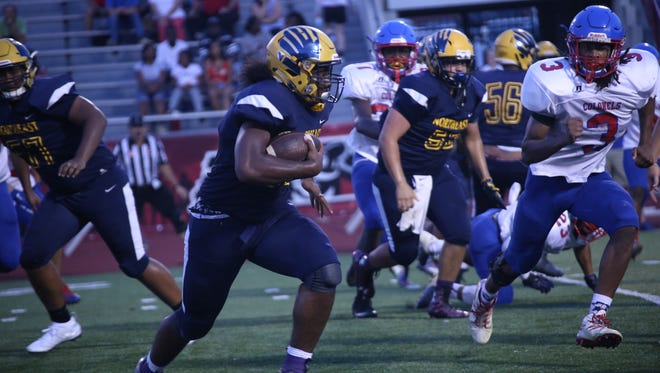 Northeast running back Tyrique Freeman gains yards against Christian County during the TOA Jamboree on Friday at Austin Peay.