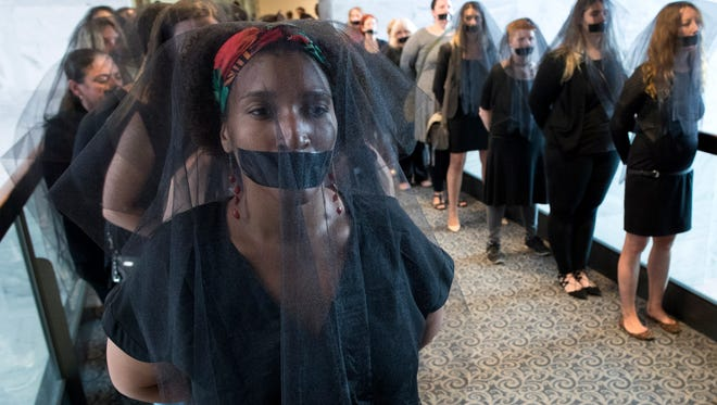 Women's reproductive rights activists that oppose the nomination of circuit judge Brett Kavanaugh to be an Associate Justice of the Supreme Court, protest wearing black veils and tape over their mouths outside the hearing room during the Senate Judiciary Committee's confirmation hearing on Kavanaugh, on Capitol Hill in Washington, D.C., on Sept. 7, 2018.