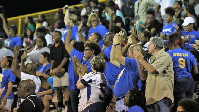 North Side fans cheer as the Indians play Milan on Sept. 7, 2018.