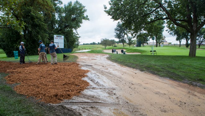 Weller Brothers Landscaping workers add mulch to the walkways at Minnehaha Country Club for the Sanford International on Wednesday, Sept. 19, 2018 in Sioux Falls, S.D.