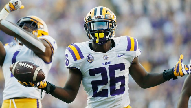 LSU safety John Battle (26) celebrates after he intercepted a Georgia pass during the fourth quarter of an NCAA college football game Saturday, Oct. 13, 2018, in Baton Rouge, La. (Bob Andres/Atlanta Journal Constitution via AP)