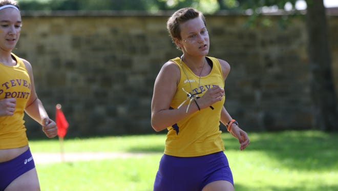UW-Stevens Point freshman cross-country runner Kalena Clauer was diagnosed with thyroid cancer as a senior in high school.