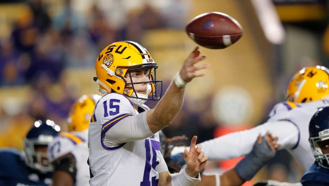 LSU backup quarterback Myles Brennan (15) from Long Beach passes in the second half of the Tigers' 42-10 win over Rice in Baton Rouge on Saturday night.