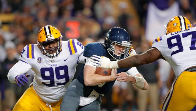 Rice quarterback Shawn Stankavage (3) is sacked by LSU nose tackle Ed Alexander (99) and defensive end Glen Logan (97) in the first half of an NCAA college football game in Baton Rouge, La., Saturday, Nov. 17, 2018. (AP Photo/Gerald Herbert)