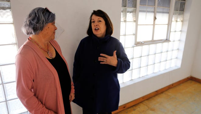 Karen Ellsbury, left, and Ronna Jordan tour the upstairs space at 305 W. Main Street that soon will serve as the offices of Jordan's Houses for Hope nonprofit organization.