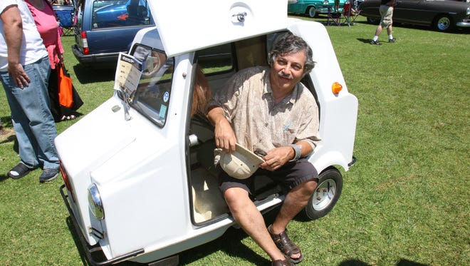 Steve Mandell from Glendora, Calif., and his 1973 Acoma Mini Comtesse at the Concours D'LeMons in Seaside. Calif.