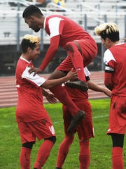Hueneme's Diego Caballero, top, celebrates with Oscar Perez, from left, Erik Lopez and J.P. Ortiz following Perez's goal against Pacifica that gave Hueneme a 2-1 lead in the game.