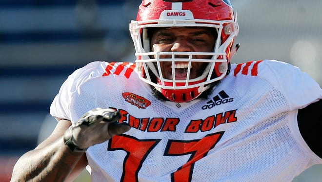 Guard Isaiah Wynn, of Georgia, reacts to a drill during the South team's practice for the Senior Bowl in Mobile, Ala., on Jan. 25, 2018.