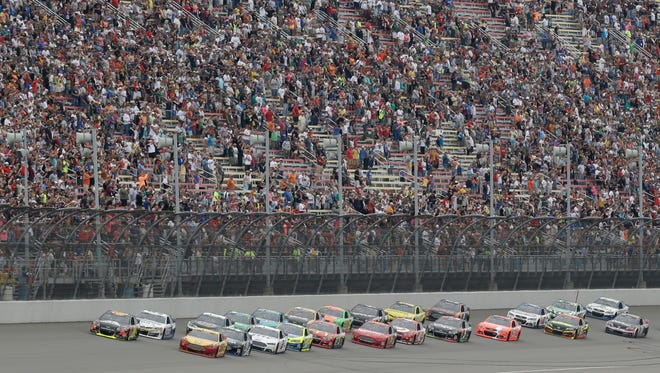 Pole sitter Jeff Gordon leads the field to the green flag during the NASCAR Sprint Cup Series Pure Michigan 400 at Michigan International Speedway in Brooklyn on Aug. 17, 2014.