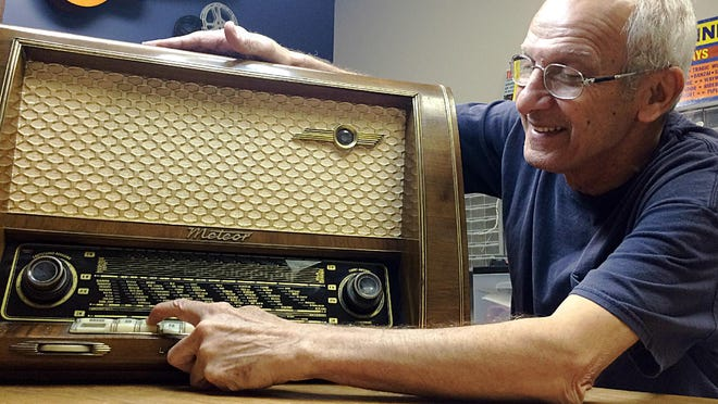 Jahn Oraha, owner of Sound Stage Electronics in Dickson, looks at the Loewe-Opta Meteor radio made in Germany in the mid-1950s which he repaired for a Maury County man.